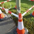 Red and white telescopic demarcation poles linked around orange and white cones