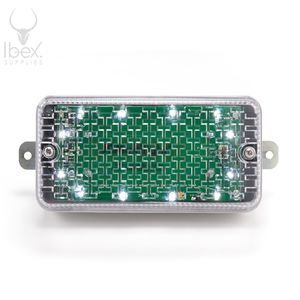 Battery powered bulkhead light with clear lens on white background
