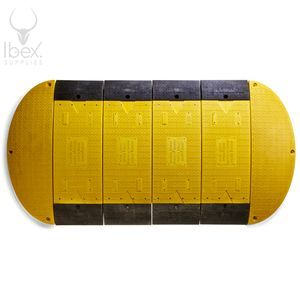 Yellow and black GRP road plate on white background