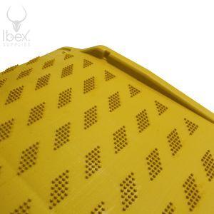 Yellow kerb ramp on white background