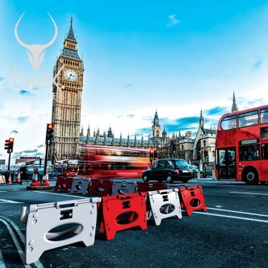 Red and White Alphabloc barriers linked together in a line on a London street with Big Ben in the background