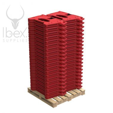 Red Alphabloc barriers stack up high on wooden pallet