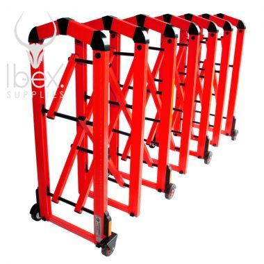 Expanded red Centipede retractable barrier on white background