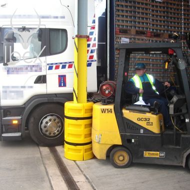 Yellow column protector in use in warehouse