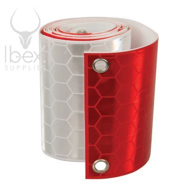 Roll of red and white Fencebrite reflective stips on a white background