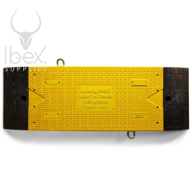 Aerial view of yellow and black GRP road plate on white background