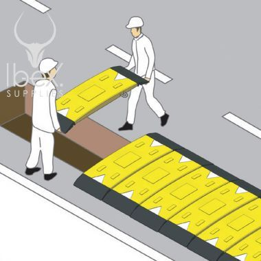 Installation of yellow and black GRP road plate in situ