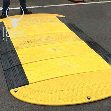 Yellow and black GRP road plate laid on a road