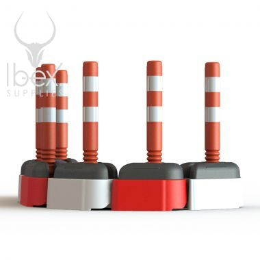 Red and white road rocks with orange and white poles