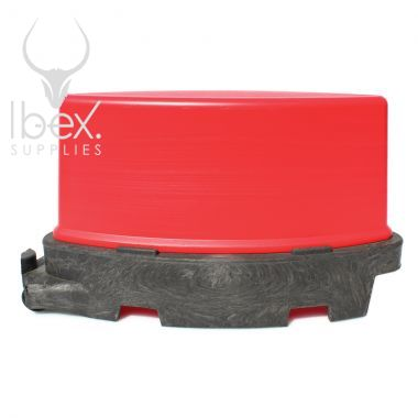 Side view of Red and black road runner barrier on white background