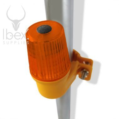 Orange side mount barrier safety lamp with amber lens on white background
