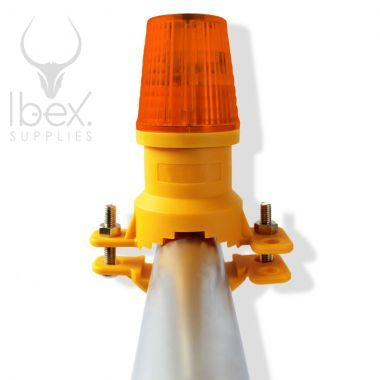 Vertical mount barrier safety lamp with amber lens on white background