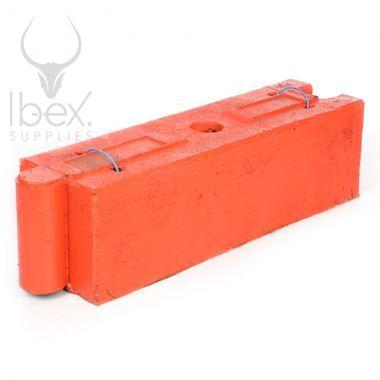 Orange traffic log barrier on a white background